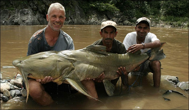 Jeremy Wade with his Goonch catfish and fishing guides.