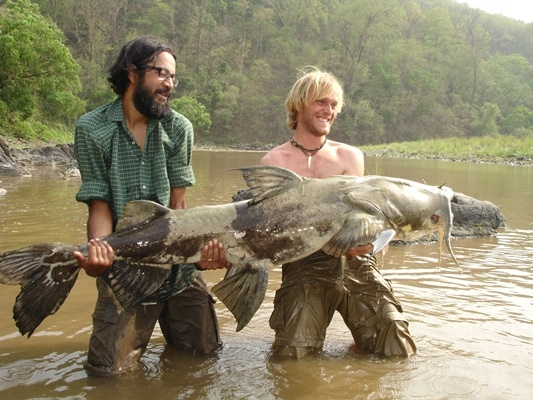 Jakub Vagner with his catch of a Goonch on the Ramganga river, guided by Vinay Badola from Otter Reserves